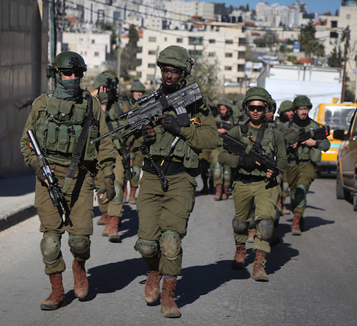 Israeli soldiers patrol the streets during the demolition of the house of Palestinian family Abu Humaid, in al-Amari refugee camp in Ramallah, in the West Bank December 15, 2018. Photo by Flash90